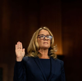 Christine-blasey-ford-is-sworn-in-prior-to-giving-testimony-news-photo-1041686608-1538067388